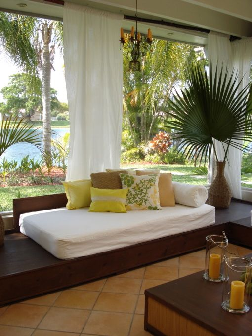 love an outdoor bed. maybe use a mattress with a colorful cover so it would be very comfortable and not just like patio furniture.