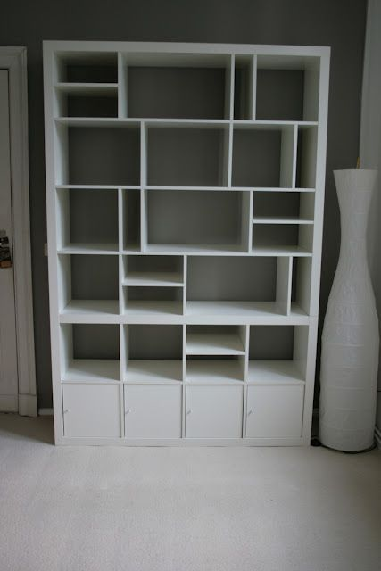 Think outside the box when constructing an Ikea Expedit bookshelf to construct your own custom shelves like this one from Ikea Hackers made from 3 separate Expedit units.
