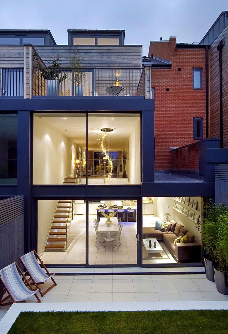 When these homeowners purchased this new build, 3000 square foot townhouse in North London's Crouch End, they turned it over to LLI Design during the build stage to heighten the drama in certain areas while maintaining a livable and warm residence.