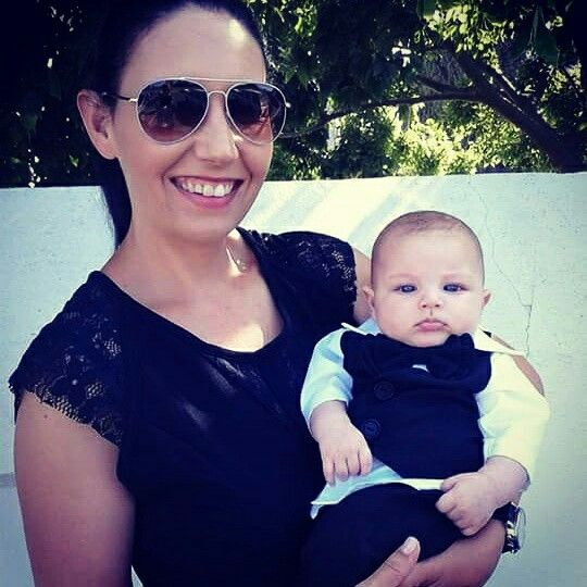 Gorgeous Adrian in his linen black baptism outfit