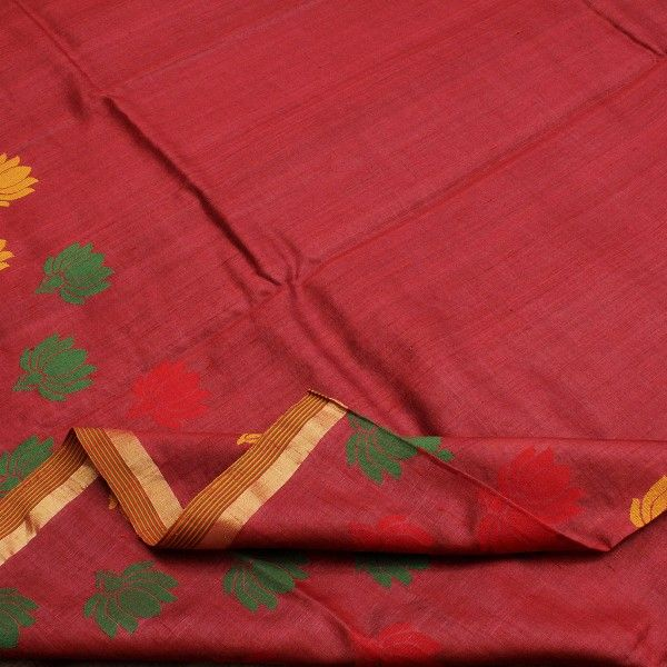Variegated lines on kumkum red #Tussar silk create a textured effect across the body of this sari. The lower half is sprinkled with green and yellow lotus motifs, symbolizing purity and divinity. The border is a trim of a #zari stripe and striped border. The pallu is ablaze with stripes in auspicious colours of kumkum, mehandi and haldi. A lovely peach blouse with stripes adds the final touch of class. Code 280511115.