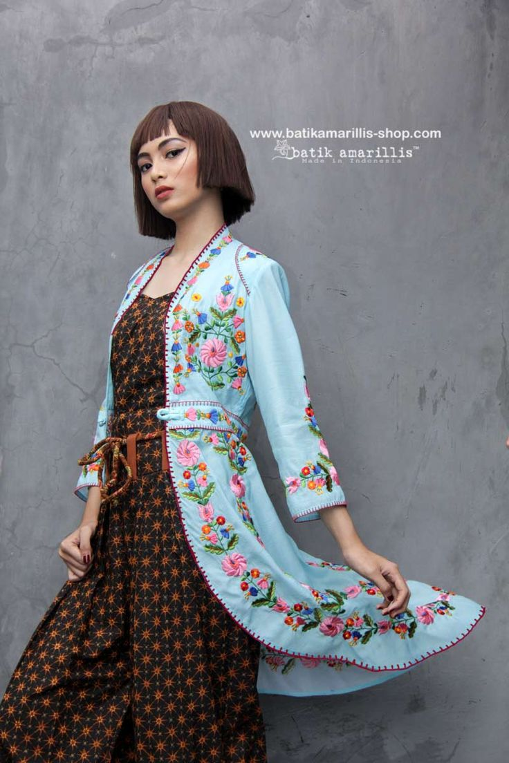 Batik Amarillis made in Indonesia www.batikamarillis-shop.com BEHOLD ...... HAVE YOU SEEN SOMETHING which delicately decadent & beautiful ?! an outfit which fit to the Queen !! - we proudly present Batik Amarillis's Ildiko 3 - such a beautiful, elegant & unique long tailed outer which features Hungarian embroidery inspired on baby blue organza