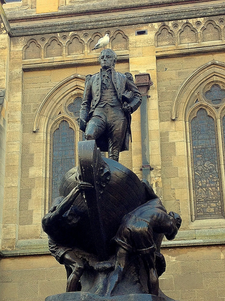 St Paul's Cathedral. Matthew Flinders standing grandly in a vessel being hauled by several bare chested slaves. A class-hating lefty seagull with a strong sense of injustice poos copiously on his head.