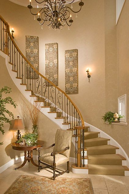 a nice touch for large blank walls that no one knows what to do with - traditional staircase by Suzanne Price Design, LLC