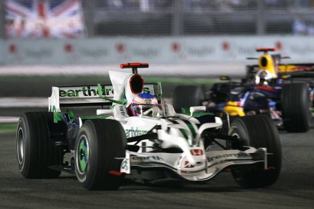 Honda's Jenson Button leads Red Bull's David Coulthard during the Singapore Grand Prix