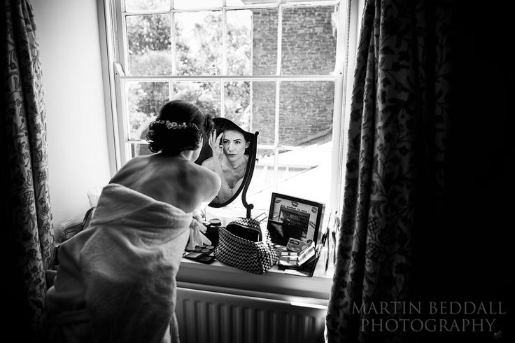 Bride gets ready at dewsall court