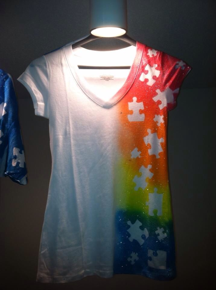 Fabric spray paint shirts for Autism Speaks- use old puzzle pieces or cut out freezer paper to iron down, then spray with Tumble Dye - http://www.dharmatrading.com/dyes/tumble-dye-tie-dye-2-oz.html