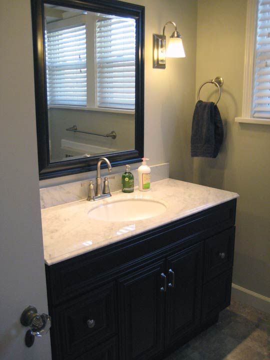 Cherry vanity carrera marble sage green walls for Sage green bathroom