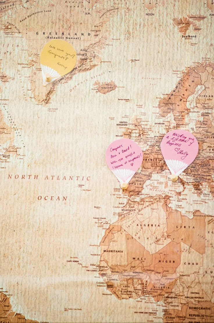 Because the Bride & Groom love to travel, guests wrote their wishes on hot air balloon-shaped cards and pinned them onto a map of the world ~ their favorite places to travel. Fun! Photography by carolinetran.net