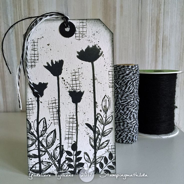 On this black & white tag I sponged the wildflowers using a Darkroom Door stencil and black Distress Oxide ink. I stamped the Mesh tex...