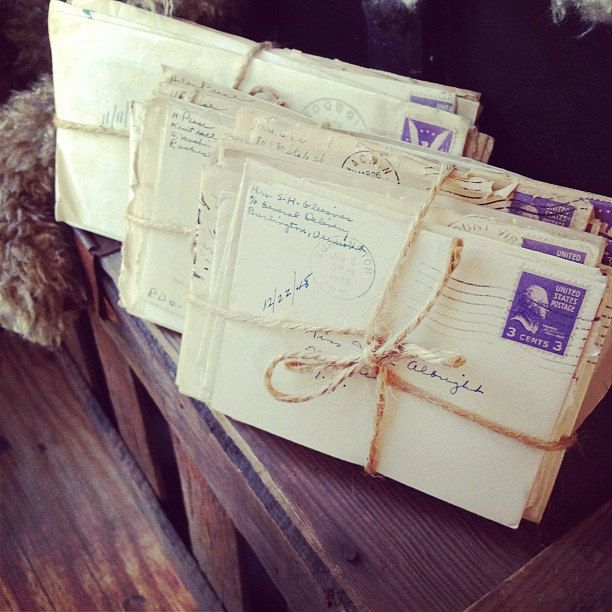 bundles of real antique letters as wedding table decor