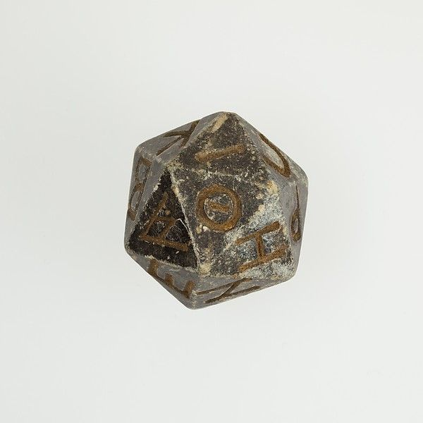 2000 year old Egyptian 20 sided die with Greek characters. 2nd century B.C.–4th century A.D.