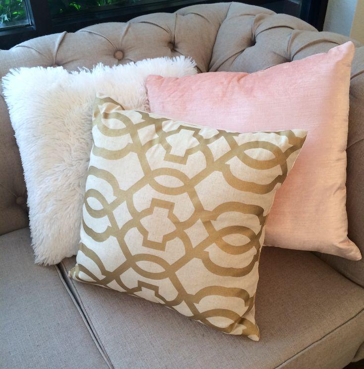 blush, gold, and white throw pillows...