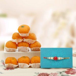 Desi Ghee Motichur Ladoo With Rakhi online delivery @way2flowers Place your order here http://www.way2flowers.com/rakhi-gifts