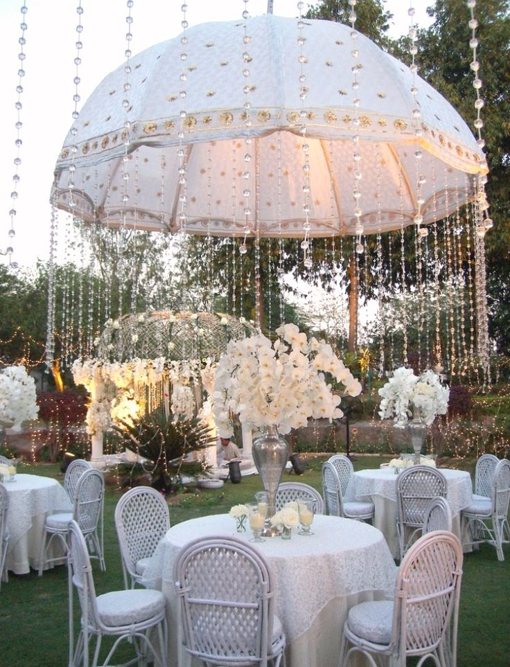 Create a rain shower from crystals with an embellished umbrella centerpiece as a sparkling event theme, perfect for a bridal shower or baby shower.