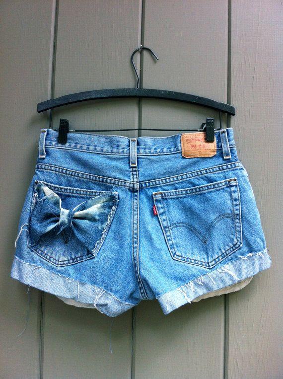 Levi's High Waisted Cut Off Denim Shorts - Light Denim Pockets Showing Bleach Splashed Bow Pocket SIZE LARGE $32