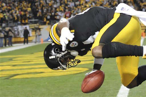 Antonio Brown flips into the end zone scoring a TD after a punt return in the 1st quarter against the Bengals. 12/28/2014.