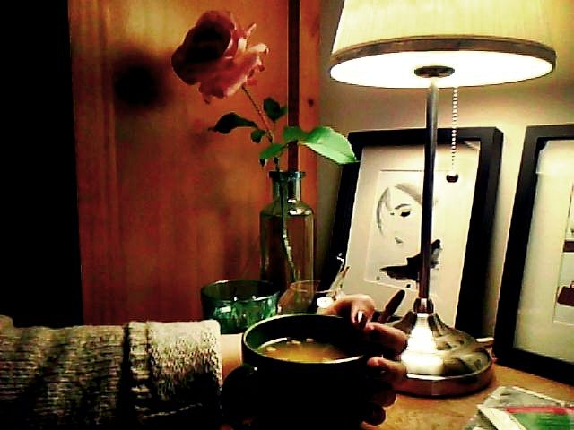 In a relaxed mood: warm soup from a mug, cardigan, and it's raining outside