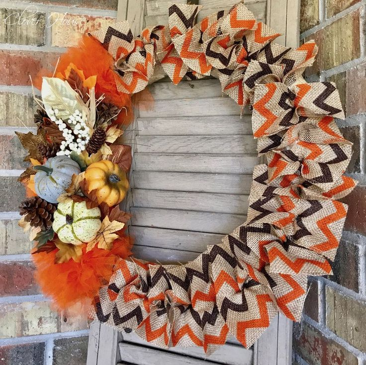 A blogger cuts strips of burlap ribbon from Walmart—look at her amazing fall front door idea!