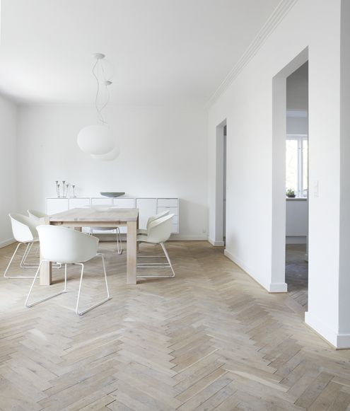 Pristine white walls + soft herringbone wooden floors. Ordrup House by Danish Norm Architects.