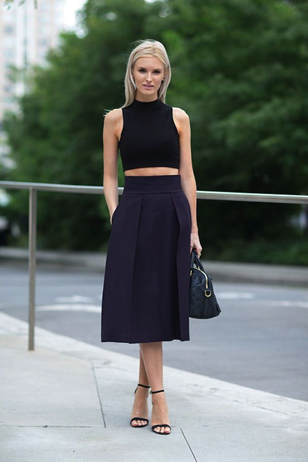 FASHION WEEK STREET STYLE BLACK AND NAVY BLUE LOOKS KATE DAVIDSON HUDSON CROP BLACK TANK TOP PLEATED NAVY SKIRT ANKLE STRAP HEELED SANDALS HARPERS BAZAAR