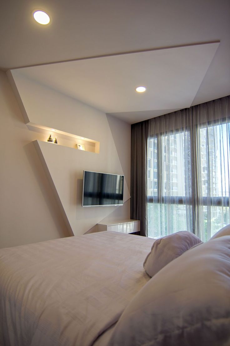 asymmetrical apartment design with undulating surfaces in. Black Bedroom Furniture Sets. Home Design Ideas