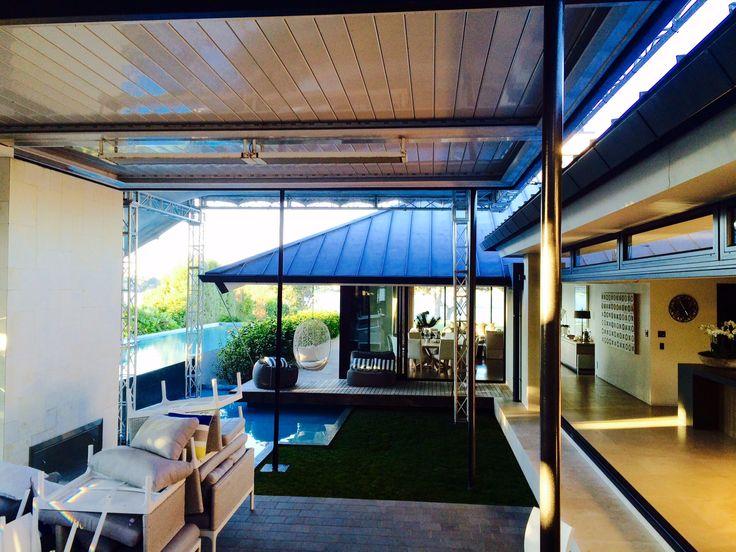 Truss over split-level louvretech roofing creating weatherproof flow between outdoor spaces