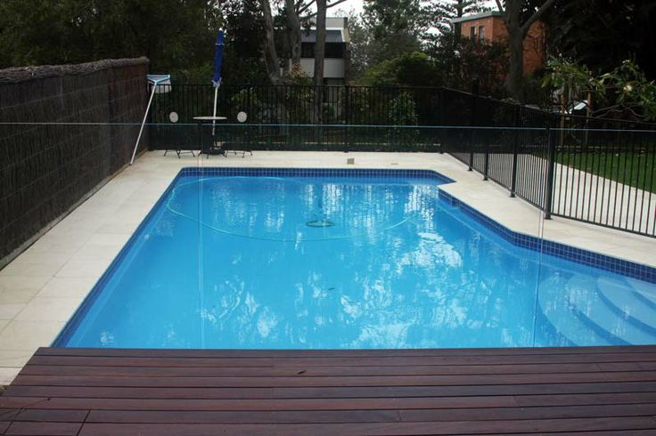 Pool renovation in Newport. Madagascar Tumbled Limestone Tiles from Gaia Stone. Work was done by Form Landscapes.