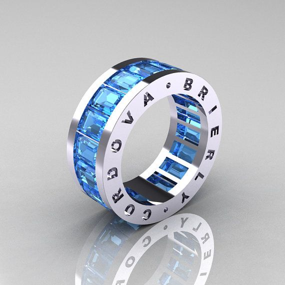 Mens Modern 10K White Gold Blue Topaz Channel Cluster Infinity Wedding Band R174-10WGBT. $1,499 via Etsy.