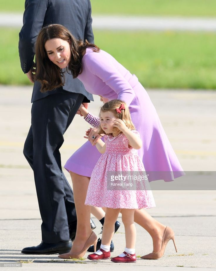 Princess Charlotte of Cambridge and Catherine, Duchess of Cambridge view helicopter models H145 and H135 before departing from Hamburg airport on the last day of their official visit to Poland and Germany on July 21, 2017 in Hamburg, Germany.