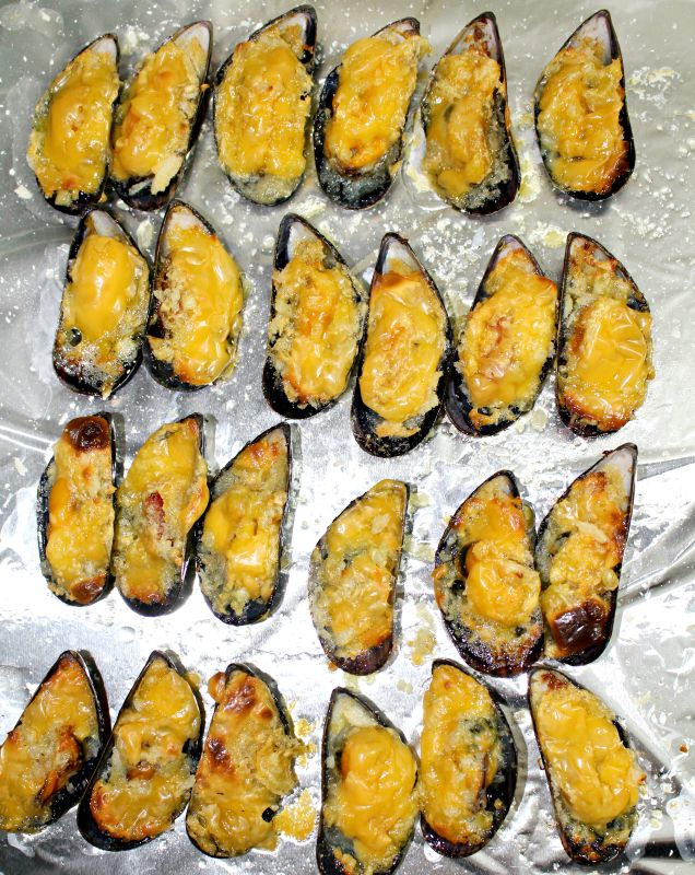 This Cheesy Baked Mussels or Baked Tahong as we call it in the Philippines are perfect appetizers and it is so easy to prepare too. The combination of butter, garlic and cheese added to the mussels just makes this dish simply delightful.