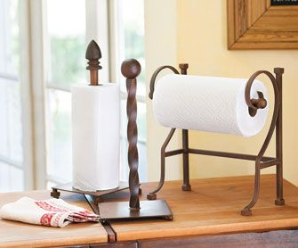 Craftsman Paper Towel Holders An elegant alternative to standard dispensers, our gorgeous paper towel holders are artisan-crafted in Tonala, Mexico. The rustic spiral paper towel holder is handmade of iron with perfect twist uprights and a stable square base. Using colorfully grained marble and rust-finished iron, our second holder sits on iron square feet. The finial tops are removable to fit any standard roll of paper towels. Each piece will vary. Imported.