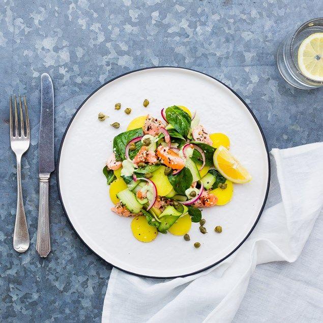 A beautiful salmon salad with saffron potatoes and sesame crust