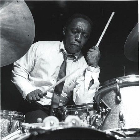 """Art Blakey at drum kit. RESEARCH by DdO:) MOST #POPULAR RE-PINS-  http://www.pinterest.com/DianaDeeOsborne/drums-drumming-joy/ - Guru of hard bop (1919-1990) began with piano lessons at school; by 7th grade playing full-time, leading commercial band. Famous drumming technique was frequent, high volume snare w bass drum accents. 1955, """"Horace Silver & the Jazz Messengers"""" formed- hard, funky, bluesy,  emphasizing rhythmic & harmonic essence. 1956, founder Silver left band, & Blakey became…"""