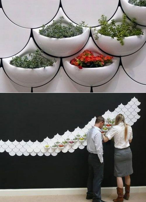 Planter wall tiles, perfect for growing fresh herbs in the kitchen or adding small plants to any interior space. Designed by the late Maruja Fuentes.