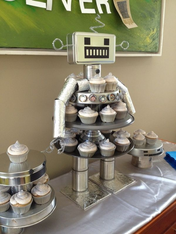 DIY Robot Cupcake Stand ~ awesome... no tutorial but it looks like its made out of household items like cans, cake pans, cookie sheets and bottle caps.
