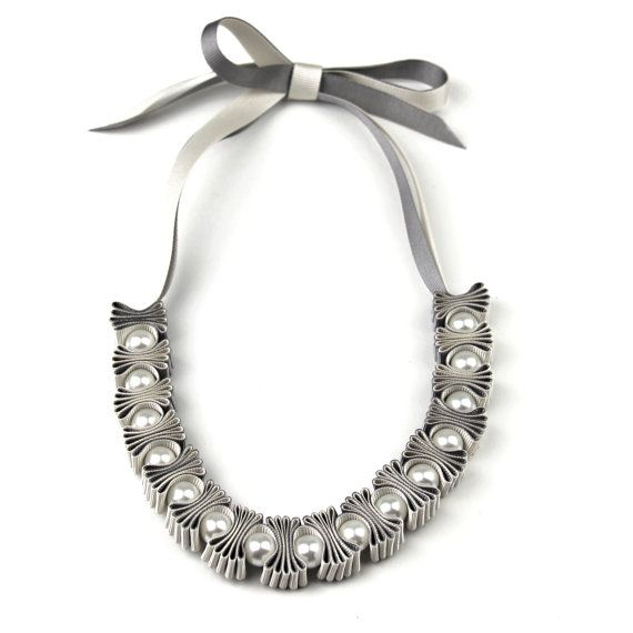 Stunning statement ribbon and pearl necklace    This beautiful necklace is created by pleating layers of grey and cream grosgrain ribbon with cream glass