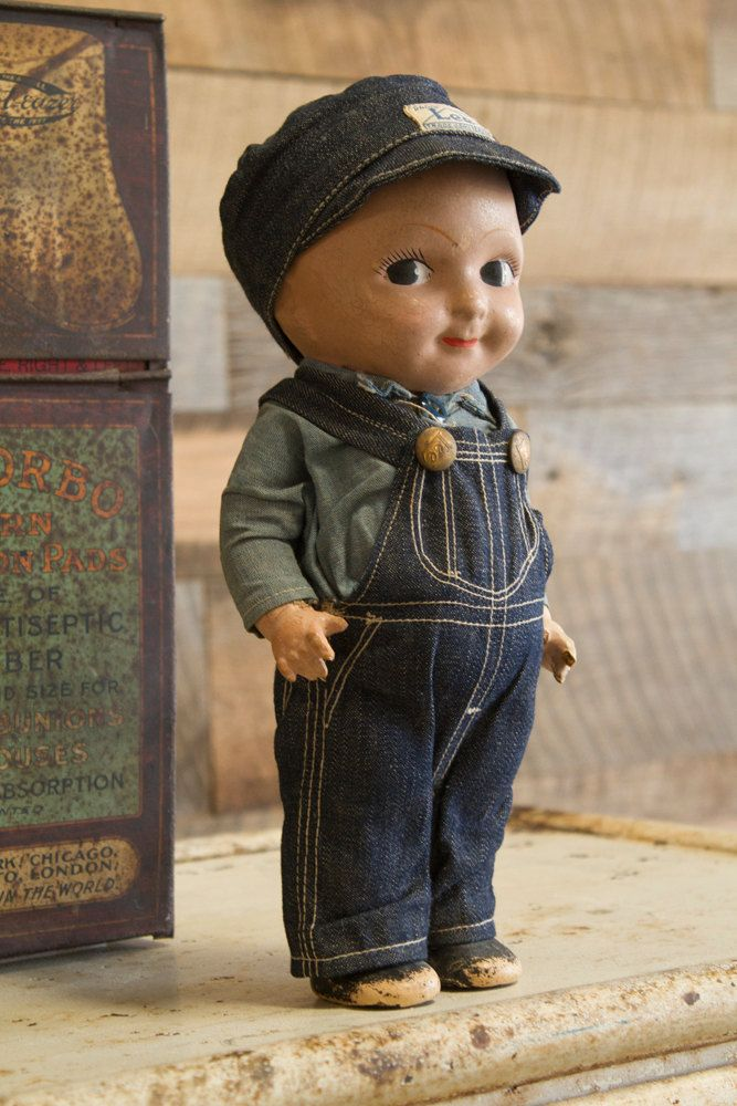 "Vintage BUDDY LEE Engineer Doll, circa 1920s | ""Originally used as an advertisement for Lee Jeans, these early pieces became an iconic American piece. This Particular doll is made from hand painted composition, and features the blue denim overalls outfit with original hat, and chambray shirt."" 