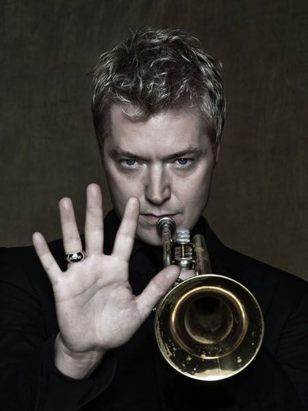 Chris Botti, holding his signature Martin Committee Handcraft trumpet made in 1939, and uses a 3C silver plated mouthpiece from Bach made in 1926.