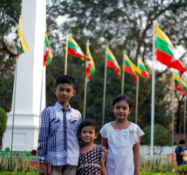 365 Challenge Day 23 - As I was trying to get a shot of the Myanmarese flags, this young boy and his sisters asked me to take his picture. How could you refuse cuties! - - - #myanmar #backpacking #explore #travelgram #instatravel #wanderlust #instagram #365project #picoftheday #instagood #travelling #365 #photooftheday #igtravel #traveling #adventure #photography #travel #backpacker #travelphotography