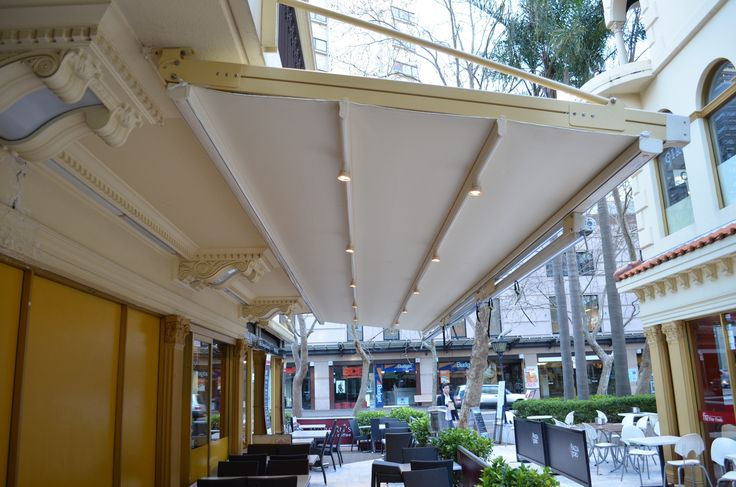 Issey retractable water proof roof system, designed, manufactured and installed for a café, allowing them to fully utilise their outdoor dining.  Awning Sydney   #awning#pergolah#roof#blind#sunshade#