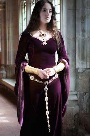 Merlot medieval gown with gold trim and belt, simple pattern.
