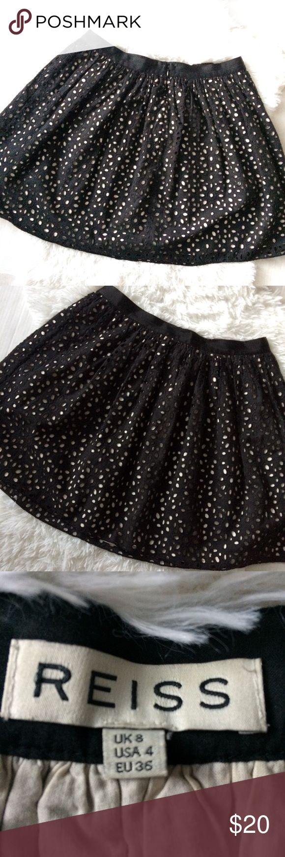 Reiss black and white skirt Adorable Reiss black and white eyelet skirt. Perfect with tights this time of year or on its own with heels or flats. Size US 4. Reiss Skirts