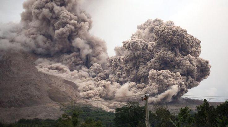 Mount Sinabung releases pyroclastic flows as seen from Tiga Serangkai, North Sumatra, Indonesia, Saturday, June 13, 2015. (AP Photo/Binsar Bakkara)  | The Weather Channel