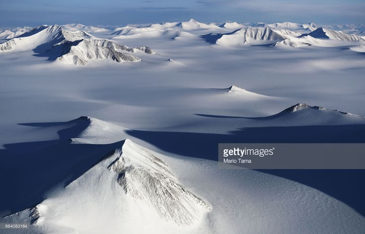 A section of an ice field is seen from NASA's Operation IceBridge research aircraft on March 29, 2017 above Ellesmere Island, Canada. The ice fields of Ellesmere Island are retreating due to warming temperatures. NASA's Operation IceBridge has been studying how polar ice has evolved over the past nine years and is currently flying a set of eight-hour research flights over ice sheets and the Arctic Ocean to monitor Arctic ice loss aboard a retrofitted 1966 Lockheed P-3 aircraft. According to…
