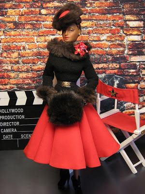 "Monolithic Studio's resident songstress, Miss Violet Waters, poses for a wardrobe test for a scene in her new musical ""Winter Baby"".Violet's hat, skirt, fur ""collar"" are all from Madra Lord's costume set, ""A Woman for all Seasons"".The fur ""collar"" was removed from the original jacket & is shown here reversed,accented with a floral corsage.The top,shoes are from ""A Lady Knows"" ensemble,fur trimmed gloves from ""Blues in the Night"", belt from The Couture Touch, and fur muff from ""Sparkling…"