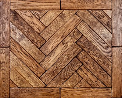 Light jacobean  Available in Prime, Natural, Rustic Grade.  The tumbled solid herringbone parquet is a unique parquet hardwood floor available from Woodcraft Flooring. It is created by hand distressing each parquet block and hand buffing them to raise the timber grain.