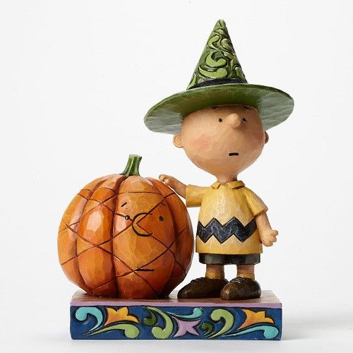 A somewhat reluctant Charlie Brown with his pensive pumpkin celebrates Halloween with all the trappings of the occasion in this delightful design combining the whimsical world of Peanuts with the arti
