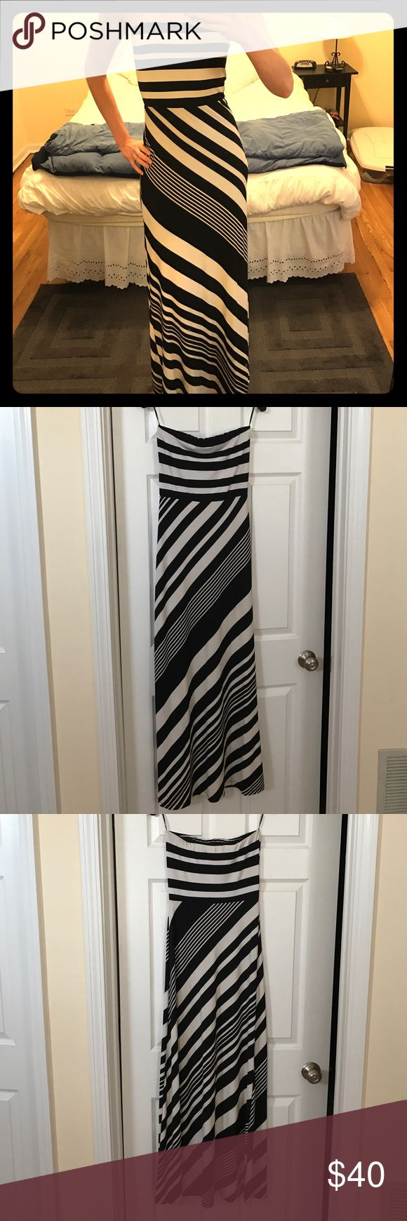 Black and white striped MM Couture maxi dress Black and white strapless maxi dress. Worn once and in great condition.  Very comfortable and stretchy. It's lined to above the knee. MM Couture Dresses Maxi