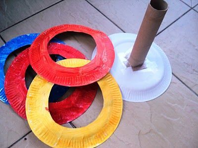 A Little Learning For Two: Paper Plate Ring Toss Game.  I'd wrap zebra print & Bright colored duct tape around the plates & tube for older kids: insert a dowel into the cardboard tube & secure thru the paper plate with a washer. Hopefully all this stuff is already in my garage.